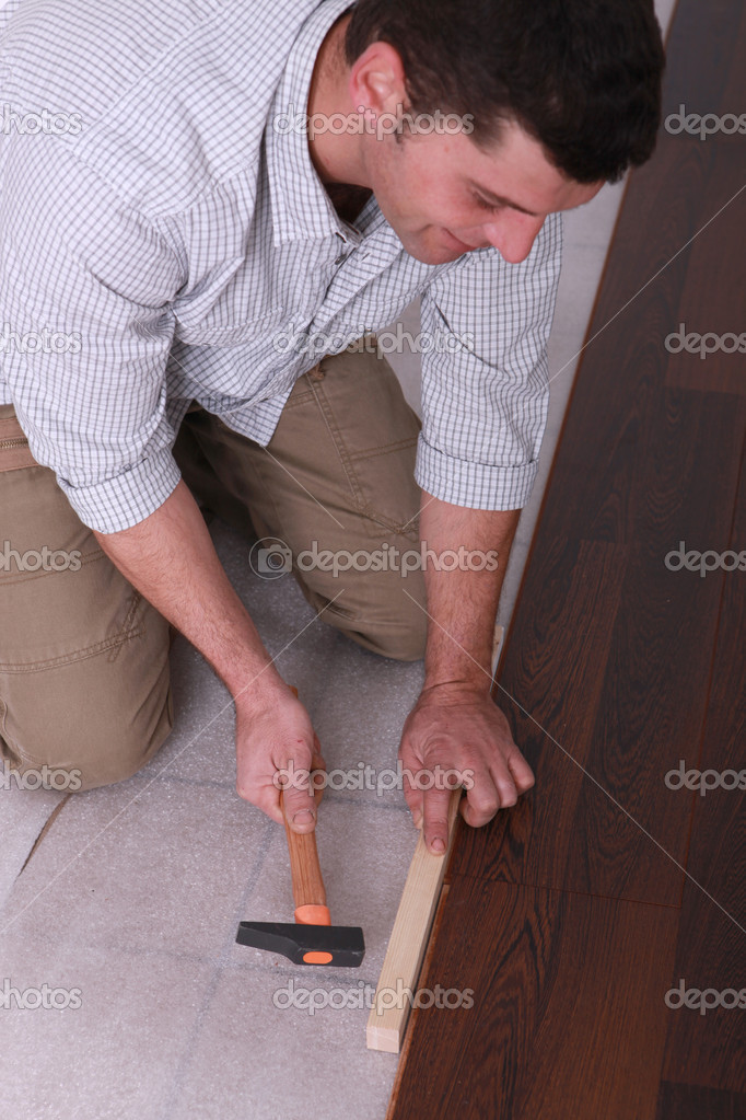 Man putting in new flooring — Stock Photo #7912535