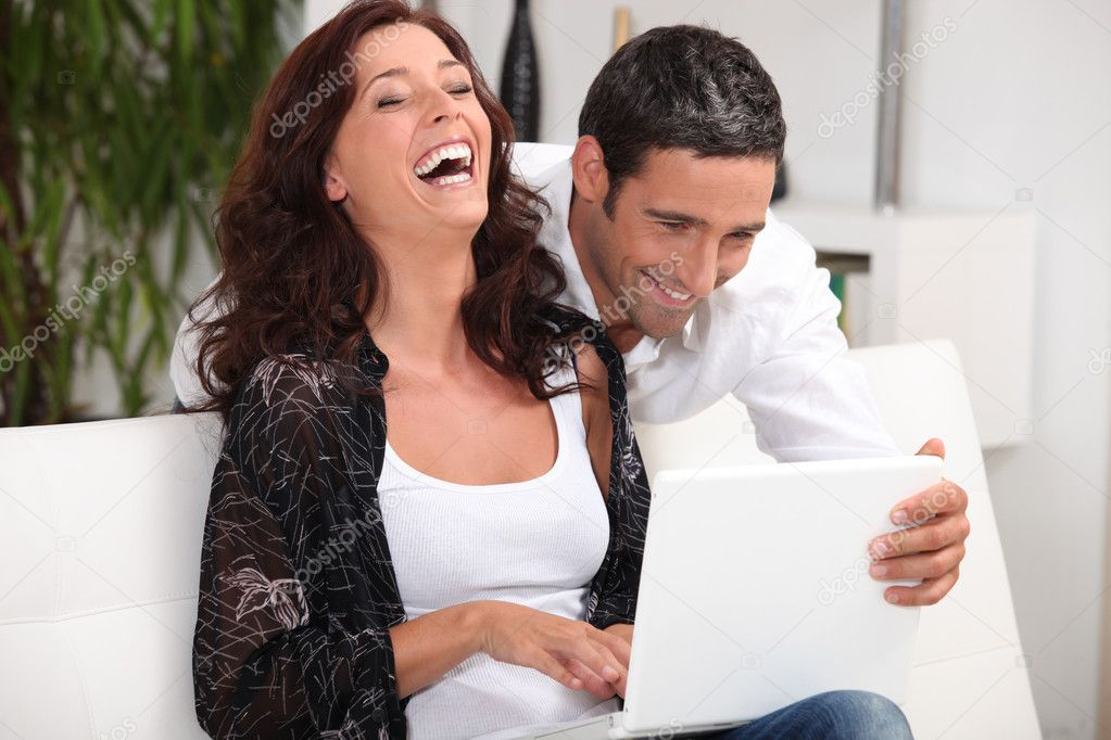 Couple laughing at their laptop — Stock Photo #7919753