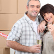 Moving day for a couple celebrating with champagne - Stock Photo