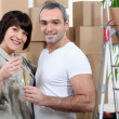 Happy couple moving into new apartment — Stock Photo