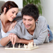Happy couple playing chess — Stock Photo
