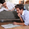 Couple plotting route on map — Foto Stock #7924128