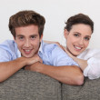 Young and relaxed couple in lounge — Stock Photo