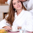 Couple having a leisurely breakfast - Stock Photo