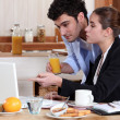 Business couple having breakfast at home — Stock Photo