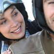 Couple riding scooter — Stock Photo #7924746