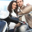 Couple stood next to scooter — Stock Photo