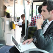 Stock Photo: Commuter on bus with laptop