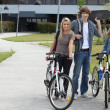 Students with bikes and skateboard — Stock Photo
