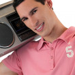 Man listening to a boombox - Stock Photo