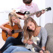 Portrait of teenagers playing the guitar — Stock Photo