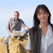 Happy couple relaxing in their farm — Stock Photo
