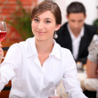 Stock Photo: Young womappreciating glass of rose wine