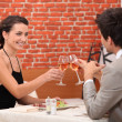 Stock Photo: Elegant couple dating in restaurant