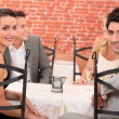 Two couples dining out in a restaurant — Stock Photo