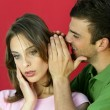 Man whispering a secret to a young woman — Stock Photo #7928967