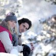 Couple taking a romantic walk in the snow — Stock Photo