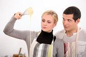Couple whisking mixture — Stock Photo