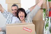 Couple celebrating moving in — Stock Photo