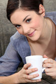 Young woman with a mug of tea — Stock Photo