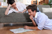 Couple plotting route on map — Stock Photo
