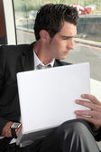 Businessman on the bus — Stock Photo