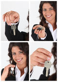 Estate agent showing house keys — Stock Photo