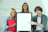 Students pointing at white board — Stock Photo