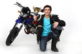Teenager with gold cup in front of a motorbike — Stock Photo