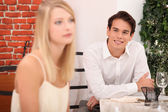 Man admiring blond woman in restaurant — Stock Photo
