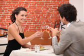 Elegant couple dating in a restaurant — Stock Photo