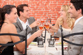 Couples clinking glasses — Stock Photo