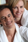 Couple in robes — Stock Photo