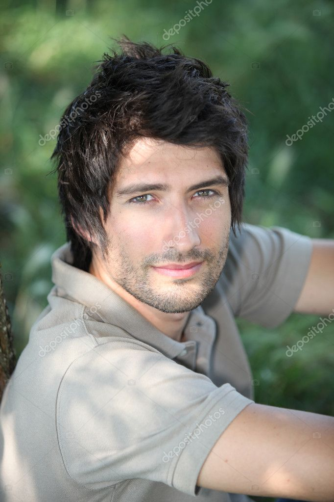 Portrait of a young man in woods — Stock Photo #7927576