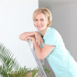 Stock Photo: Womon stepladder