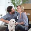 Couple and dog moving house — Stock Photo #7930313
