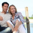 Couple relaxing on a pontoon — Stock Photo #7930396