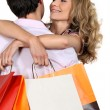 Koppel met shopping tassen — Stockfoto