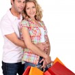 Affectionate couple with shopping bags — Stock Photo #7930660