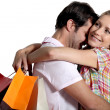 Couple with shopping bags — Stock Photo #7930674