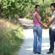 Stock Photo: Couple outdoors walking hand in hand