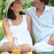 Stock Photo: Couple in park having picnic