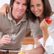 Royalty-Free Stock Photo: Married couple having breakfast in kitchen