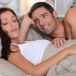 Couple laying in bed — Stock Photo