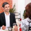 Stock Photo: Couple eating out in restaurant