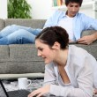 Young couple lazing about at home — Stock Photo #7931581