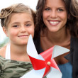 Mother and daughter with a windmill — Stock Photo