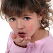 Little girl blowing kiss — Stock Photo #7931856