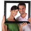 Royalty-Free Stock Photo: Couple stood with empty picture frame