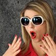 Stock Photo: Shocked woman wearing sunglasses